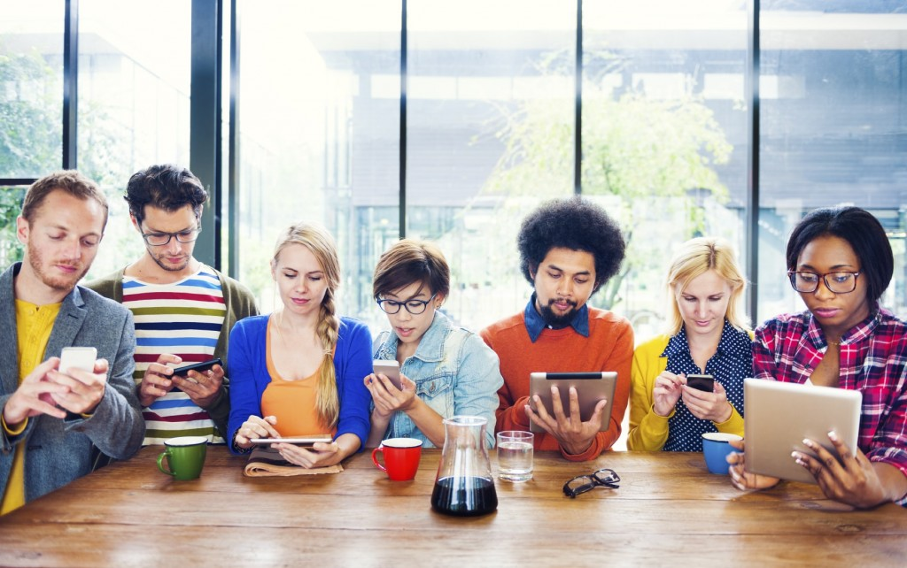 Group-of-People-Using-Mobile-Devices-iStock_000040645286_Medium-min